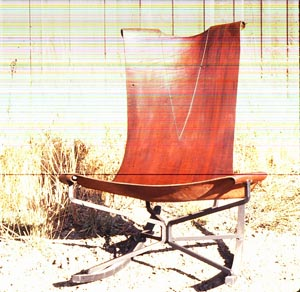 Rocking chair - showing detail on leather